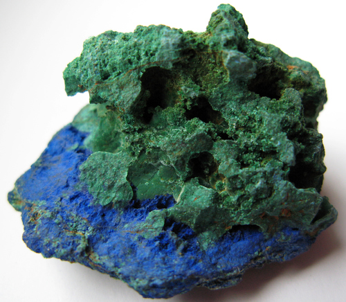 Malachite usually grows in conjunction with other minerals, most commonly Azurite.  In fact, malachite and azurite banded together in one stone is usually called azure-malachite.    -- Malachite Facts