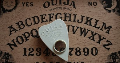 A Ouija Board and planchette.