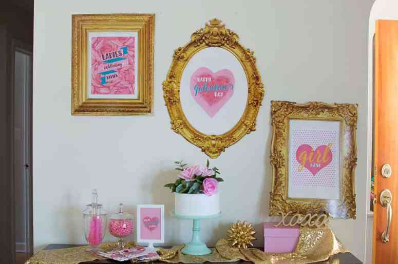 Check out this Girl Gang Galentine's Day Party with a backdrop using Oriental Trading Gold Frames with printables by Elva M Design Studio.