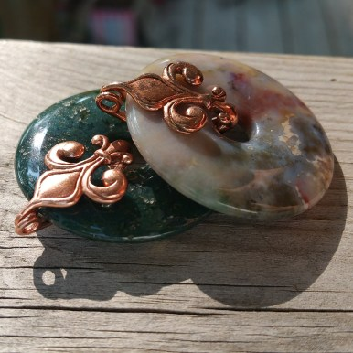 Picture jasper and moss agate with a copper finished, copper fleur-de-lis bale
