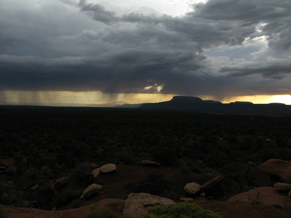 A western big sky with rain in the distance.