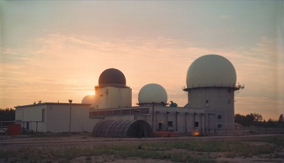 RCAF Station Lowther Ops Site, RCAF Radar Site with four domes at sunset.