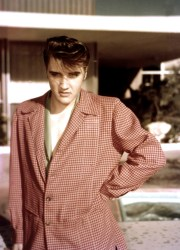 Elvis posing for some photos at the New Frontier hotel's pool area - April 1956.