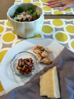 Salad with chicken, parmesan, and candied pecans.