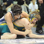 Lorain's Eli Garcia, rear, defeats Amherst's Alex Funderburg in 138 wt. class at Lorain Jan. 12.  Steve Manheim