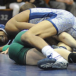 Lorain's Xaevier Edwards defeats Amherst's Tyler Harris in 120 wt. class at Lorain Jan. 12.  Steve Manheim