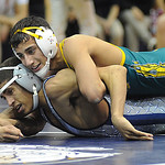 Amherst's Mark Matos, top, defeats Lorain Johnny Spinkston in 126 wt. class at Lorain Jan. 12.   Steve Manheim