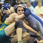 Lorain's Dominic Diaz, rear, defeats Amherst's Anthony Mendez in 106 wt. class at Lorain on Jan. 12.   Steve Manheim
