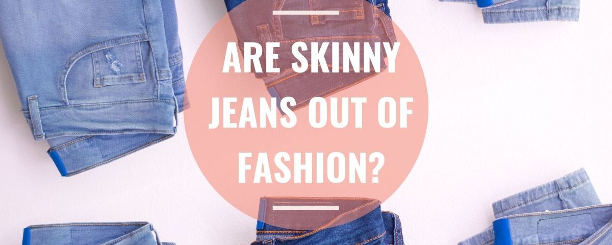 Are skinny jeans out of fashion. Blue jeans folded next to each other.