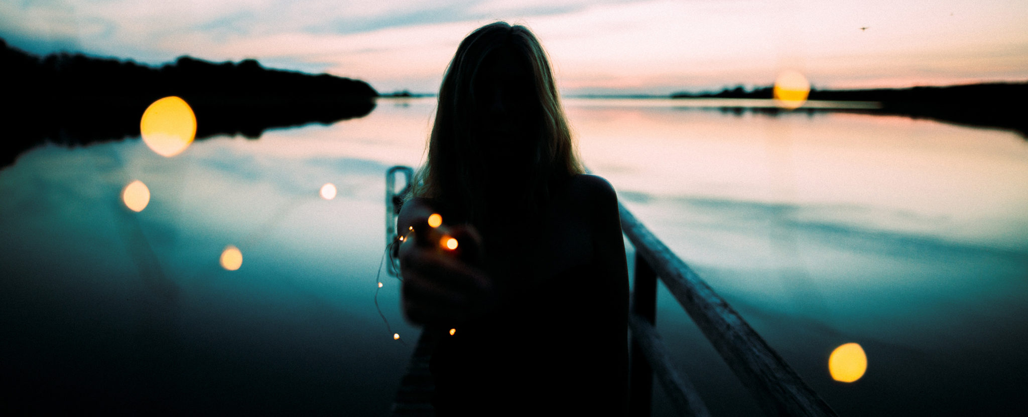 Silhouette of a girl sitting in a boat