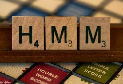 Scrabble tiles spelling Hmm