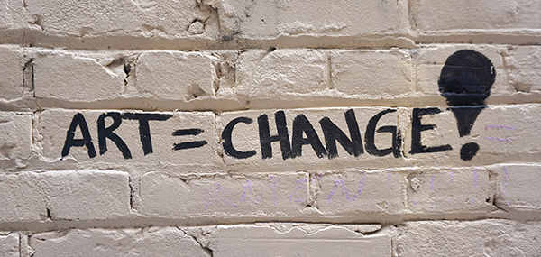 Art equals change painted on a wall