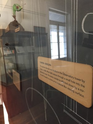 A chart explaining the history of the Museum's astronomical observation activities. The alien reflected in the glass watched stoically from across the room. Photo: Heather Cameron.