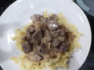 beef stroganoff over noodles