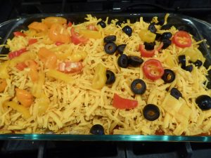 cheesy crunchy mexican casserole before baking