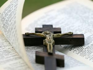crucifix lying on bible