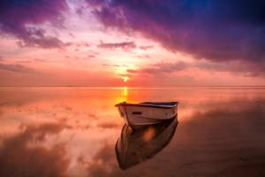 boat on ocean of grief