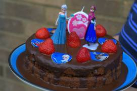 Elsa and Anna joined in on the cake celebration