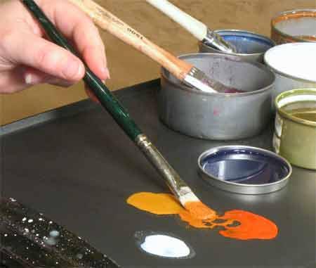 Mix encaustic paint on griddle