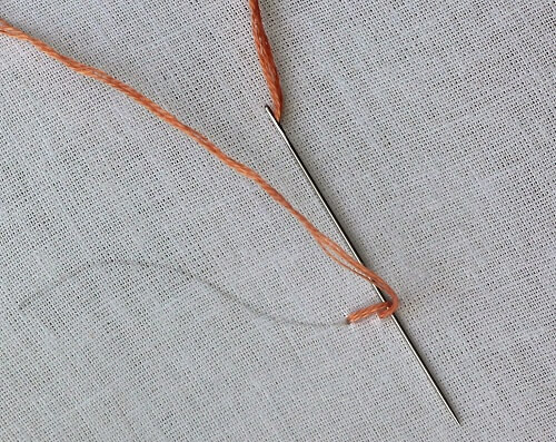 passing the thread under the stem stitch