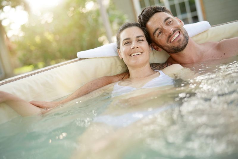 Couple enjoying relaxing time in a Hot Tub