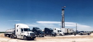 vacuum trucks lined up at the oilrig