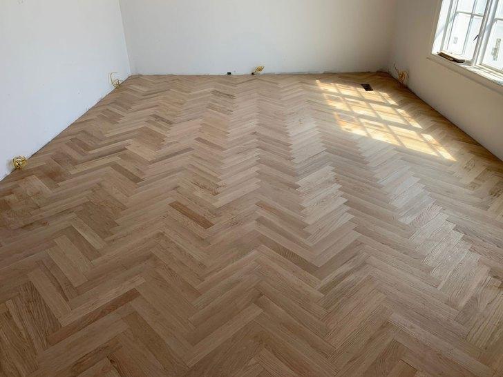 custom herringbone hardwood floor installation - finished