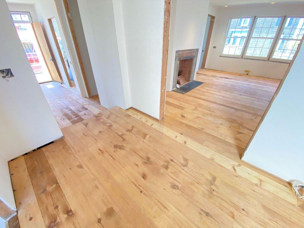 pumpkin pine flooring installation in living room
