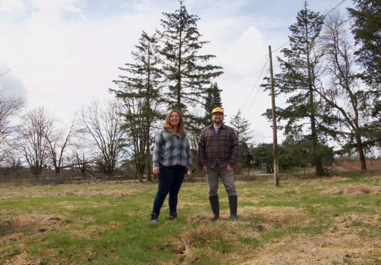 Jasmine and Brendan on their nine acre plot in Maple Ridge. EMELIE PEACOCK PHOTO.