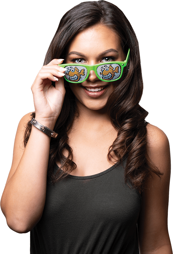 Young mixed woman, curled black hair, smiling white teeth, green sunglasses with Fishbein Orthodontics logo