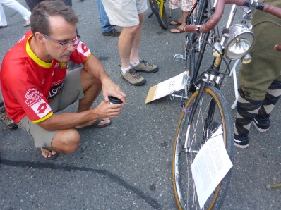 """Bob reads up on the """"Bellingham Express,"""" a 1930's era tandem kept in very nice repair."""