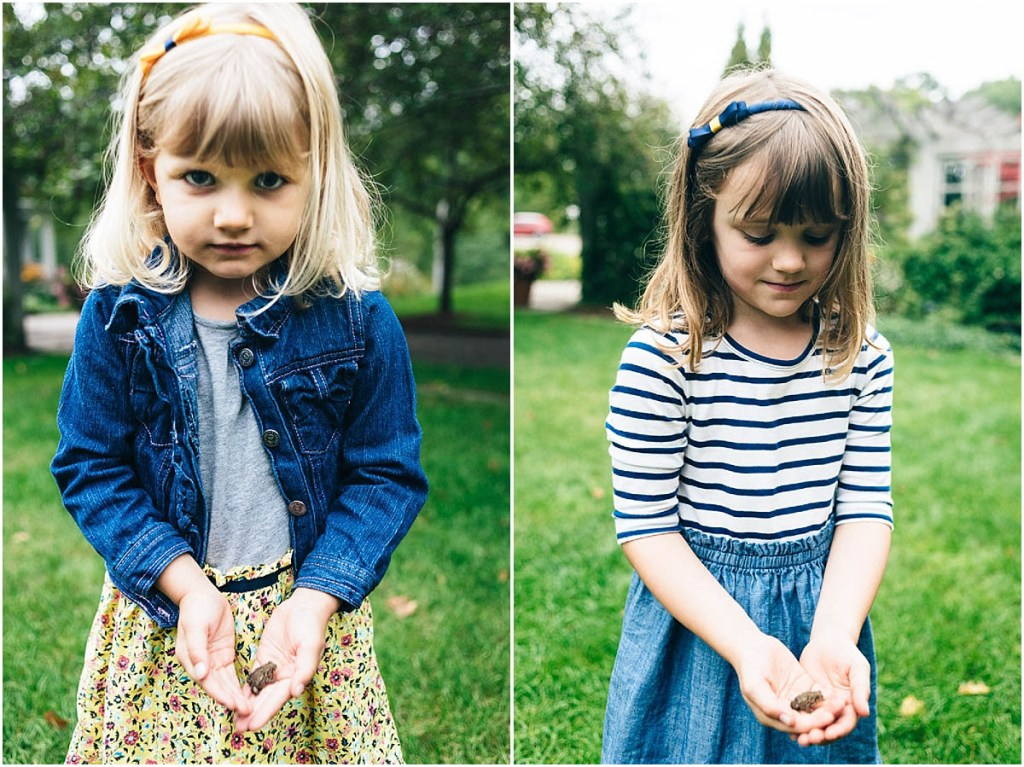 Two little girls holding frogs.