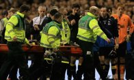 Fabrice Muamba of Bolton Wanderers Football Club is taken off on a stretcher after receiving CPR on the pitch.