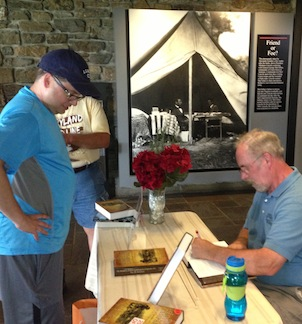 Tom Clemens signs copies of The Maryland Campaign Volume 1 (South Mountain) and Volume 2 (Antietam) for Ronald Baumgarten.