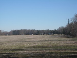 Fighting raged across this field during the battle. On the right is Oak Grove, the home of the John Haw family which lends its name to the settlement. Mr. Haw manufactured farming equipment before the war. With the outbreak of the war. When session came, the Confederates moved the Haw equipment to nearby Tredegar Iron Works in Richmond.  The fighting would reach a climax when Sheridan received reinforcements late in the day in the form of Brig. Gen. Alfred Torbert's division. At the height of the battle, George Custer led the 6th Michigan in a charge from the direction of the far wood line. Combined with Hampton's belief that his line was being simultaneously flanked, the Confederates retreated and the Federals held the field.