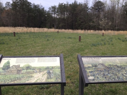 Waysides installed at Chancellorsville in the early 2000's on land once slated to be a concrete plant. The posts mark out the location of the overseer's cabin that once stood on the spot, and the signs offer explanation about the building's use on the plantation before the war and as a hospital after the battle. Discussion of plantation life and the depiction of slaves on the sign offers a nod to Emancipation memory by overtly discussing slavery.