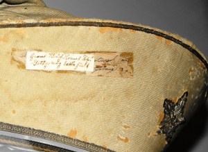 Close-up of the hat in the Texas Civil War Museum showing the labels as well as the construction and material details. Courtesy of Ray Richey, Texas Civil War Museum.