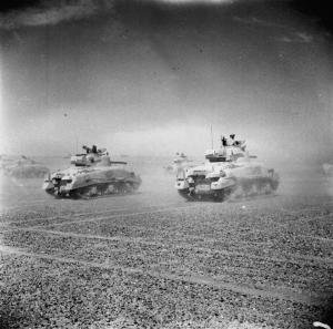 Sherman_tanks_of_the_Eighth_Army_move_across_the_desert