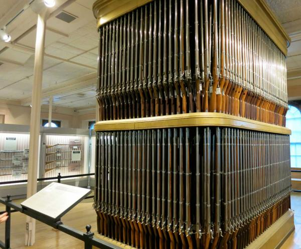 "The Springfield Armory NHS exhibit shown above, a 19th Century rifle storage, holds some of the 800,000 Springfield Model 1861 Rifle-Muskets manufactured at the Armory during the Civil War. The ""burnished arms"" standing in racks like this inspired Longfellow's poem ""The Arsenal at Springfield."" National Park Service photo."