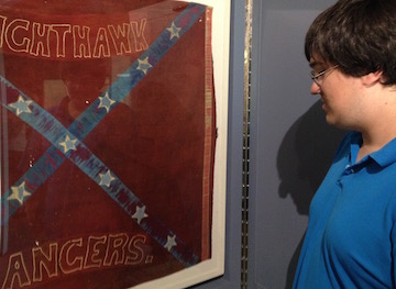 Ryan Quint inspect the Nighthawk flag on display in the museum at Monocacy National Battlefield.