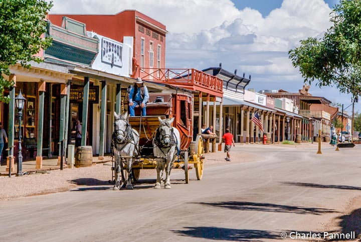 Tombstone has broad sidewalks with curb cuts at every corner. Many streets are closed to all but horse drawn traffic, so you can roll right down the middle.