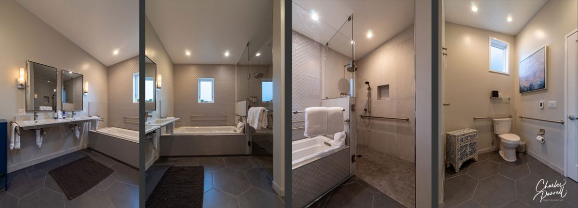 Accessible travel - roomy bathroom with roll-in shower, seperate tub and double sinks