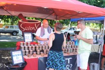 Pete explains his homemade rubs and spices at the SavorX booth.