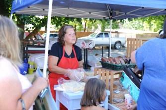 Lauri can't bag her bread fast enough at the Pleasant Prairie Farms booth.