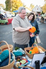 """Checking out Rebecca's hand-knitted """"pumpkin"""" hats."""