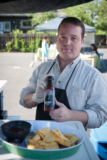 Jim Howell shows off his sauces.