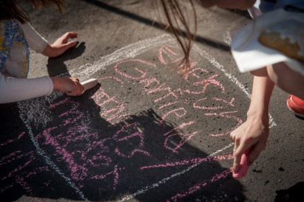 Kids make a great sign with sidewalk chalk.