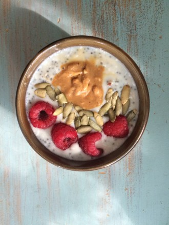 Overnight oats & chia soaked with almond milk, coconut flakes, chopped dates, hint of maple. Topped with pepitas, raspberries and natural PB.