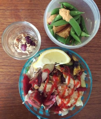 Quinoa bowl with chicken, sauerkraut & heirloom tomato, sugar snap peas with red pepper hummus, oat & nut protein ball snack!