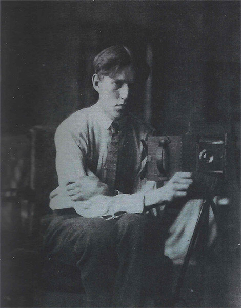 Fig 20. Dines Carlsen posed with his camera, c.1920